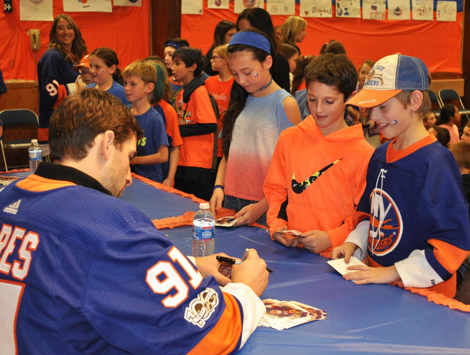 Captain John Tavares signed photos and posters for the fifth and sixth-grade students at Birch Elementary School.