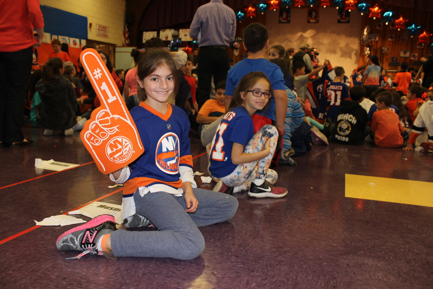 Avery Charney, a fourth-grade student, came to school decked out in Islanders gear to meet the players.