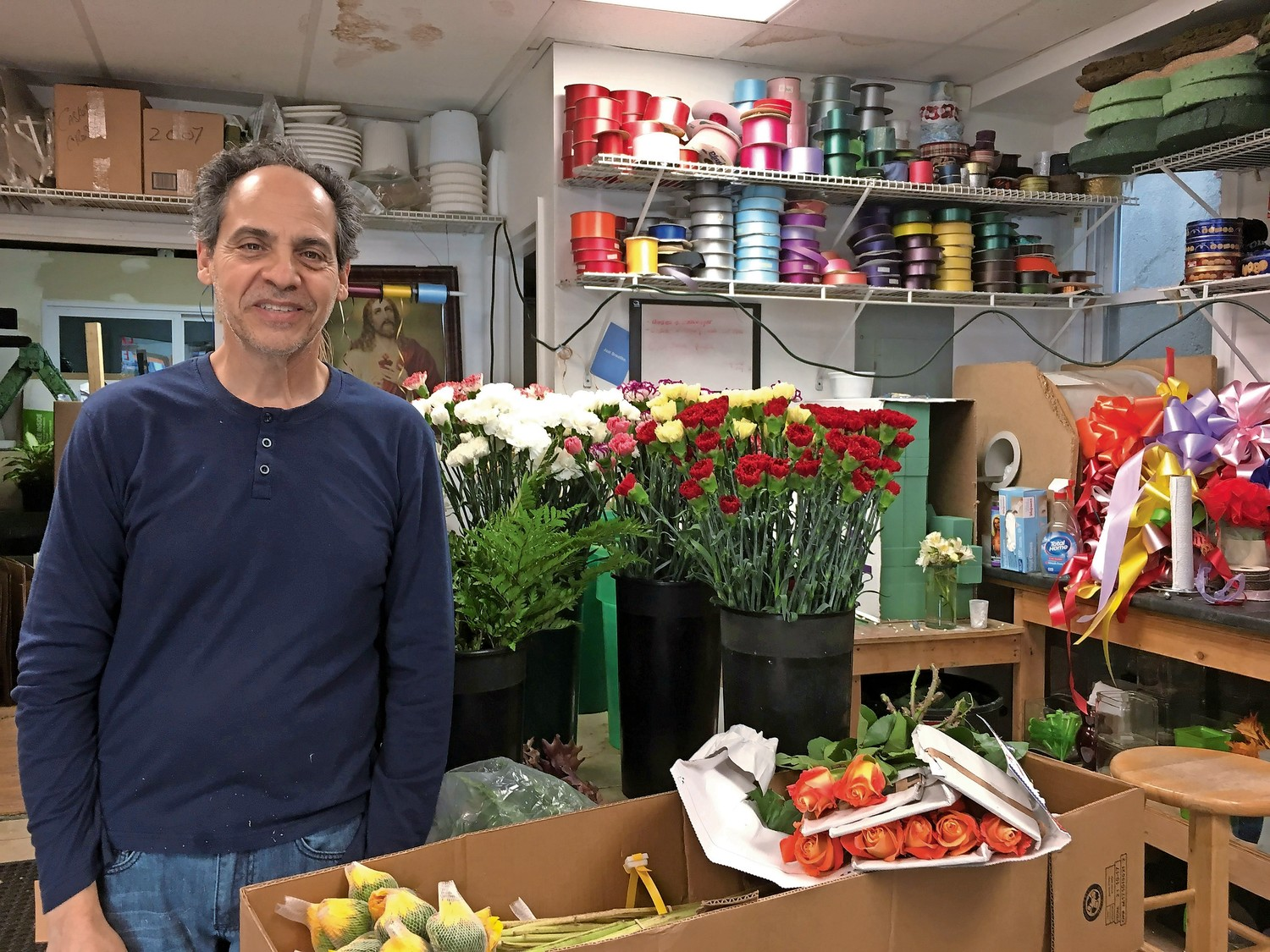 Anthony Lombardo, the owner of East Rockaway Florist, hopes to attract more customers to his store this holiday season with original arrangements and discounts.