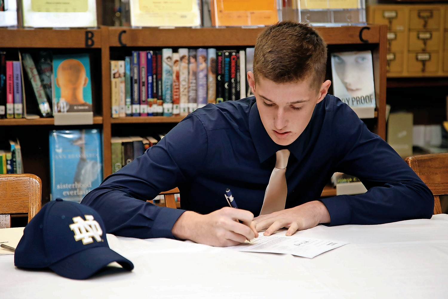 East Rockaway Junior-Senior High School student Andrew Machovec signed a national letter of intent to fence at Notre Dame on Nov. 8.