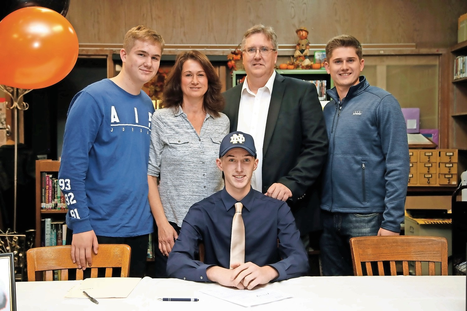 Andrew Machovec, center, with his parents Lisa and John, and brothers Matt, far left, and John, after signing his national letter of intent.