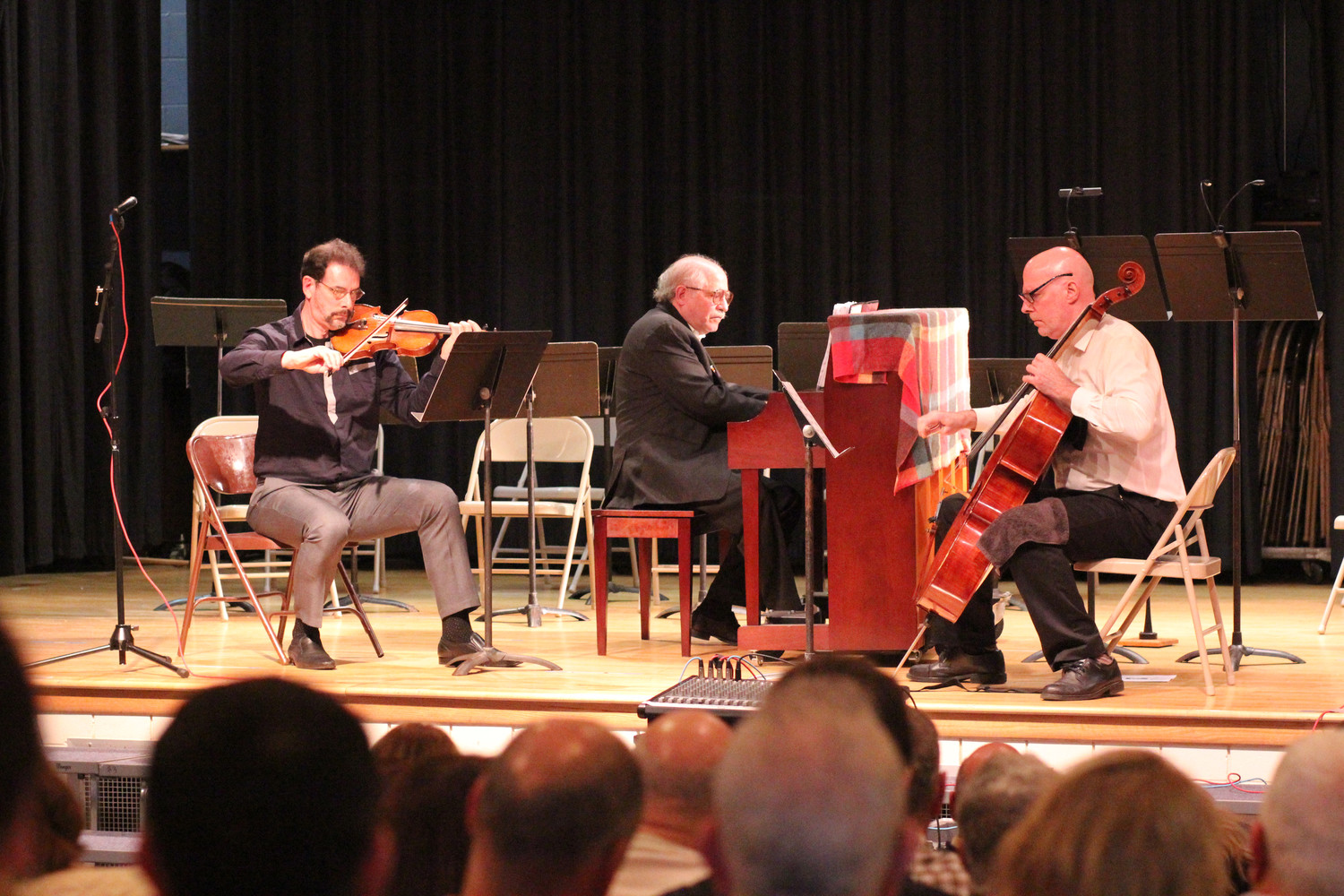 "The Dakule Trio, from left, violinist Daniel Hyman, pianist Leonard Lehrman and cellist Kurt Behnke, performed ""Trio ('Invictus'),"" a piece composed by Herbert Rothgarber in 2001, during a tribute to Rothgarber at Oceanside School No. 8 on Nov. 5."