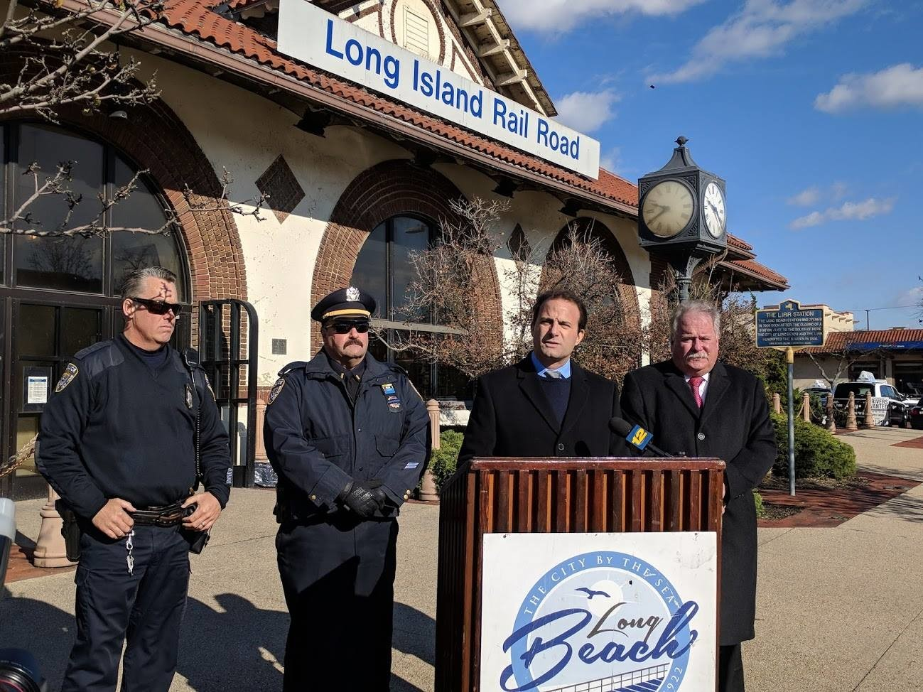 City Council Vice President Anthony Eramo, second from right, joined by Long Beach police officers and Commissioner Mike Tangney, announced plans to increase security measures at Long Beach's Long Island Rail Road station on Monday.