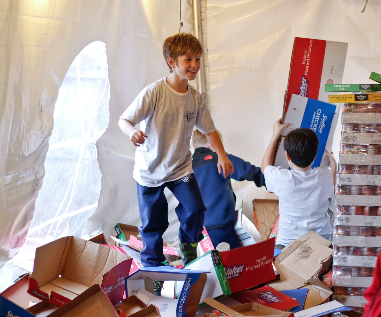 Thomas Lorenzo, 9, came up with a fun way to break down the empty boxes: jumping on them.
