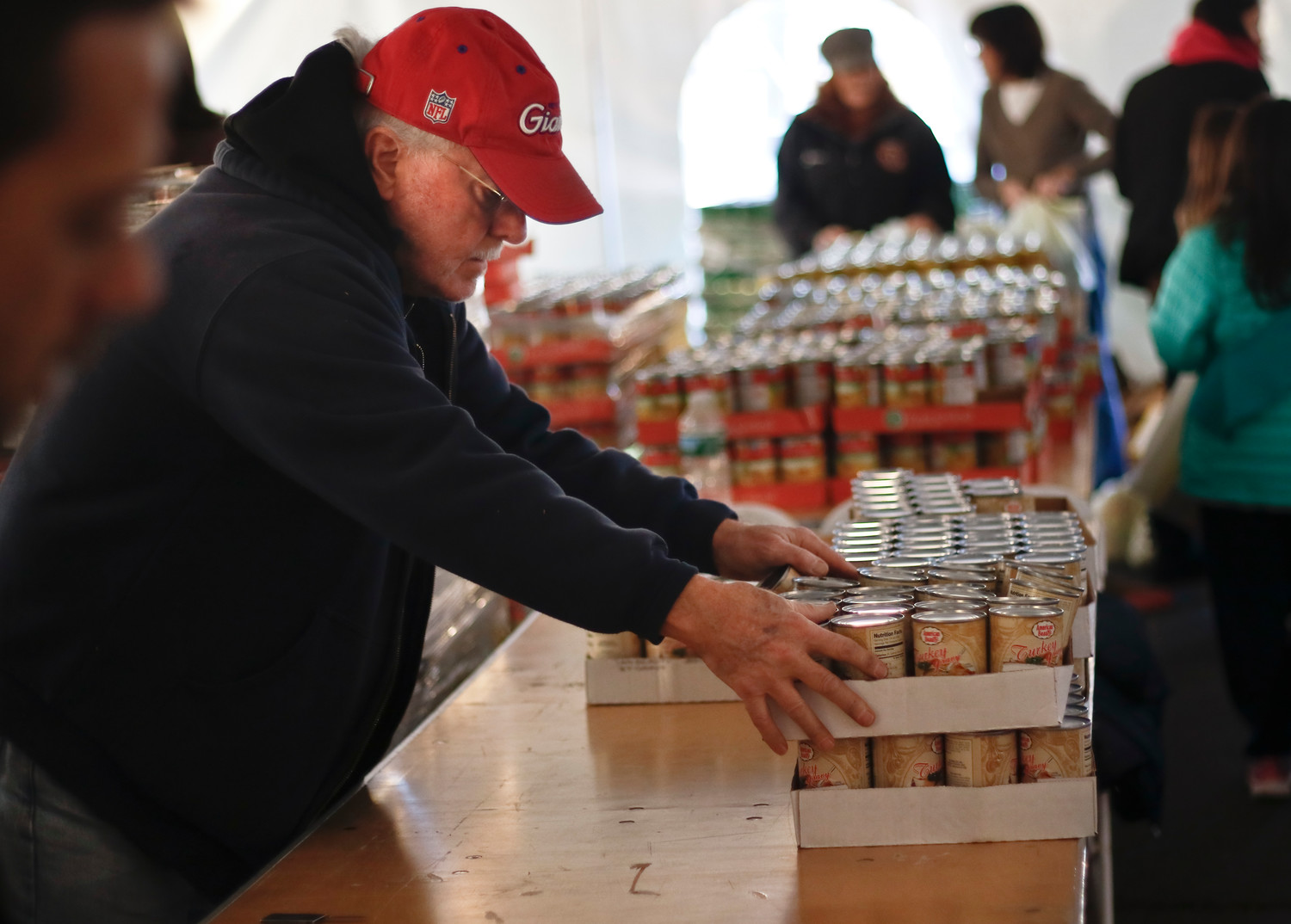 As the supplies got lower, Rockville Centre's Steve Ehrling stacked up new cases of gravy.