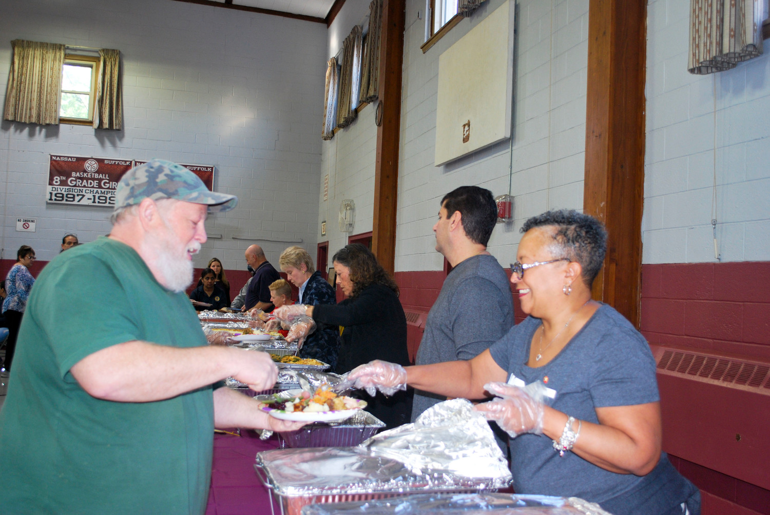 Valley Stream Lions member Monica Dingle provided service with a smile at The Club's Thanksgiving Day lunch at the St. Joseph School in Hewlett on Nov. 20.