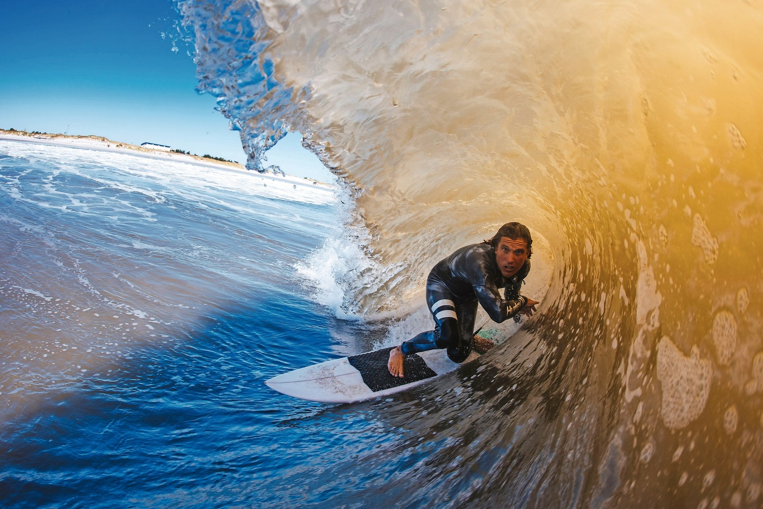 Long Beach resident and pro surfer TJ Gumiela rode a barrel in Long Beach last month, where waves with six- to eight-foot faces kept rolling in.
