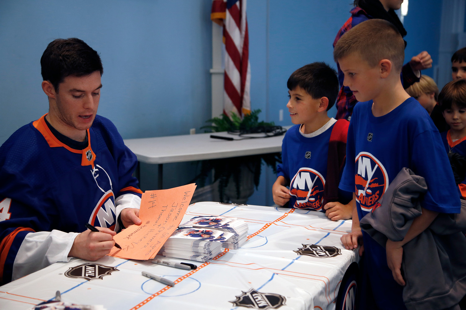 Thomas Hickey signed fourth-grader Owen Murray's poster, as his classmate Aidan Cormican looked on.
