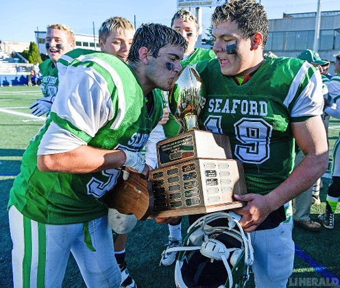 Two of Seaford's captains, Andrew Chirico, left, and Nick Calandra, carried the Long Island Class IV championship hardware after the Vikings held off Miller Place, 29-27, last Friday at Hofstra.