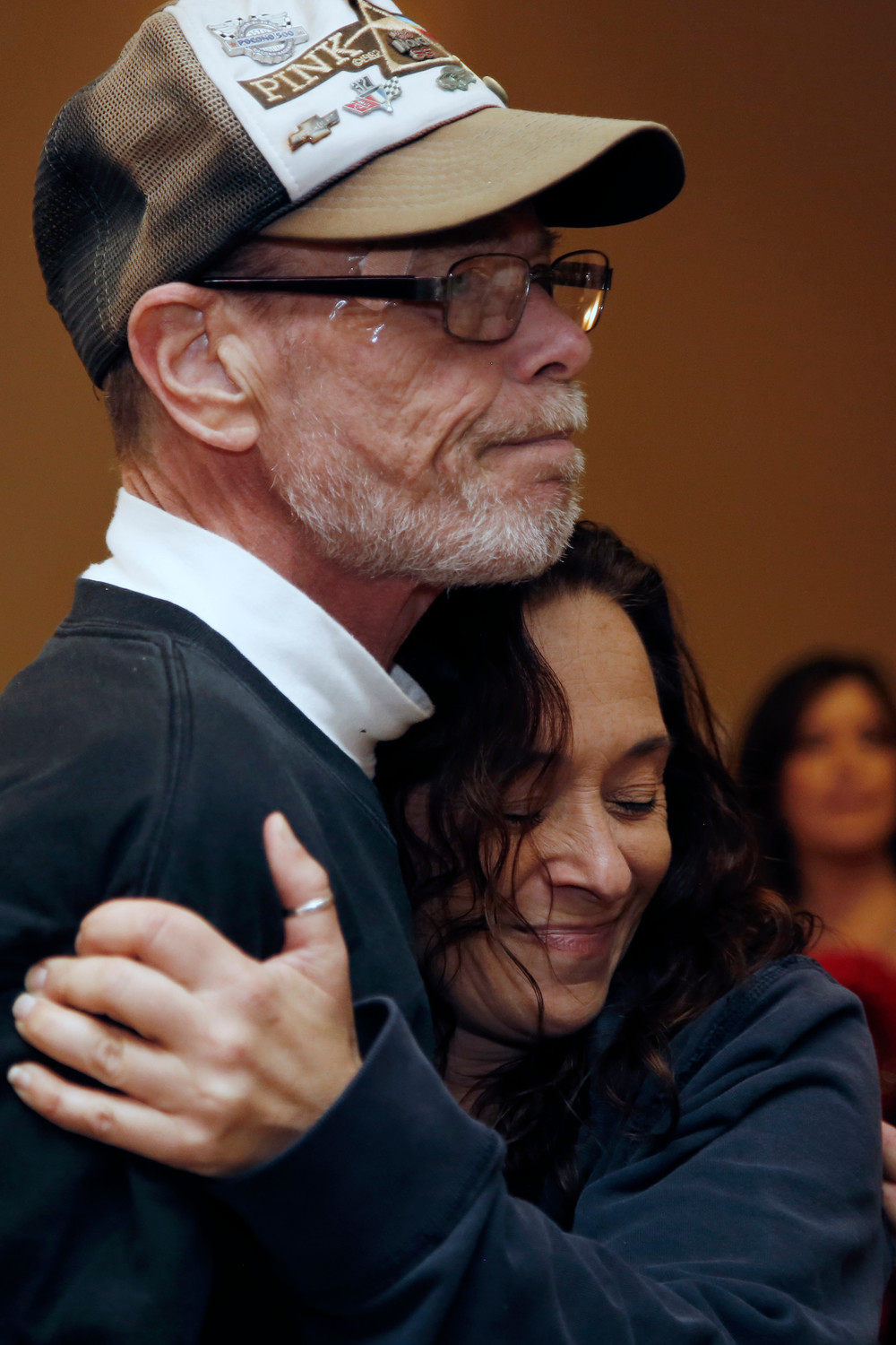 "Andrew ""Woody"" MacDonald was hugged by Michelle Croce at the Grant Avenue firehouse on Sunday."