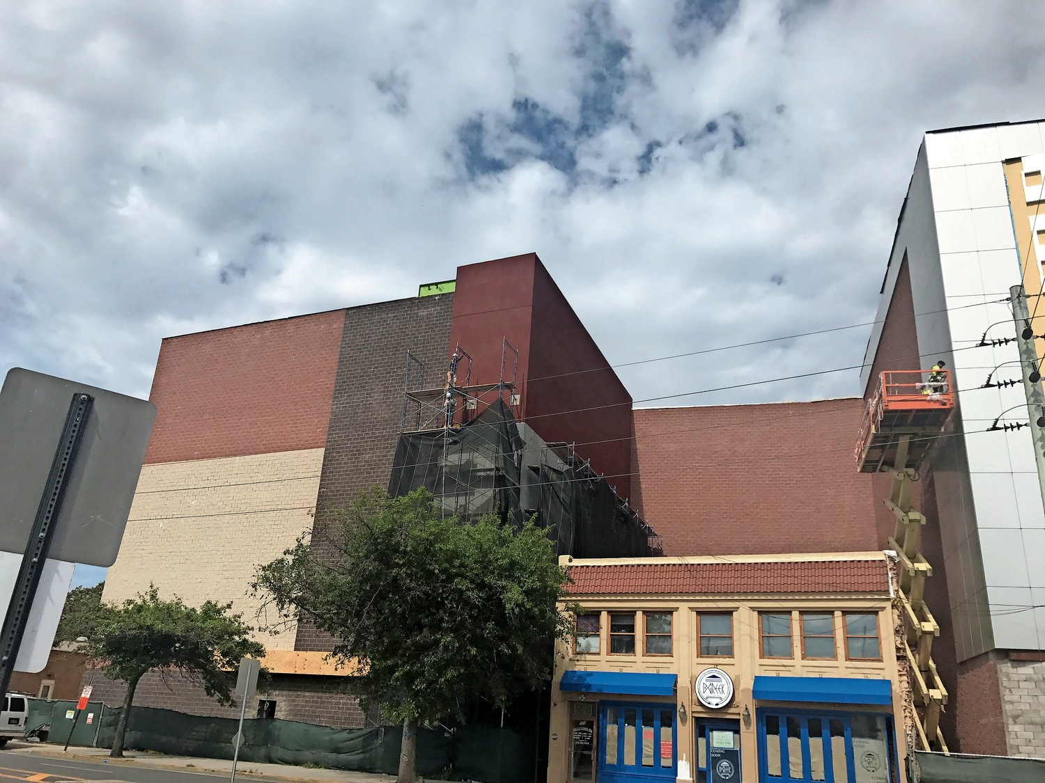 The movie theater remains under construction on Merrick Road, and Mayor Alan Beach said that it would likely open a little later than the previously announced date of Feb. 9.