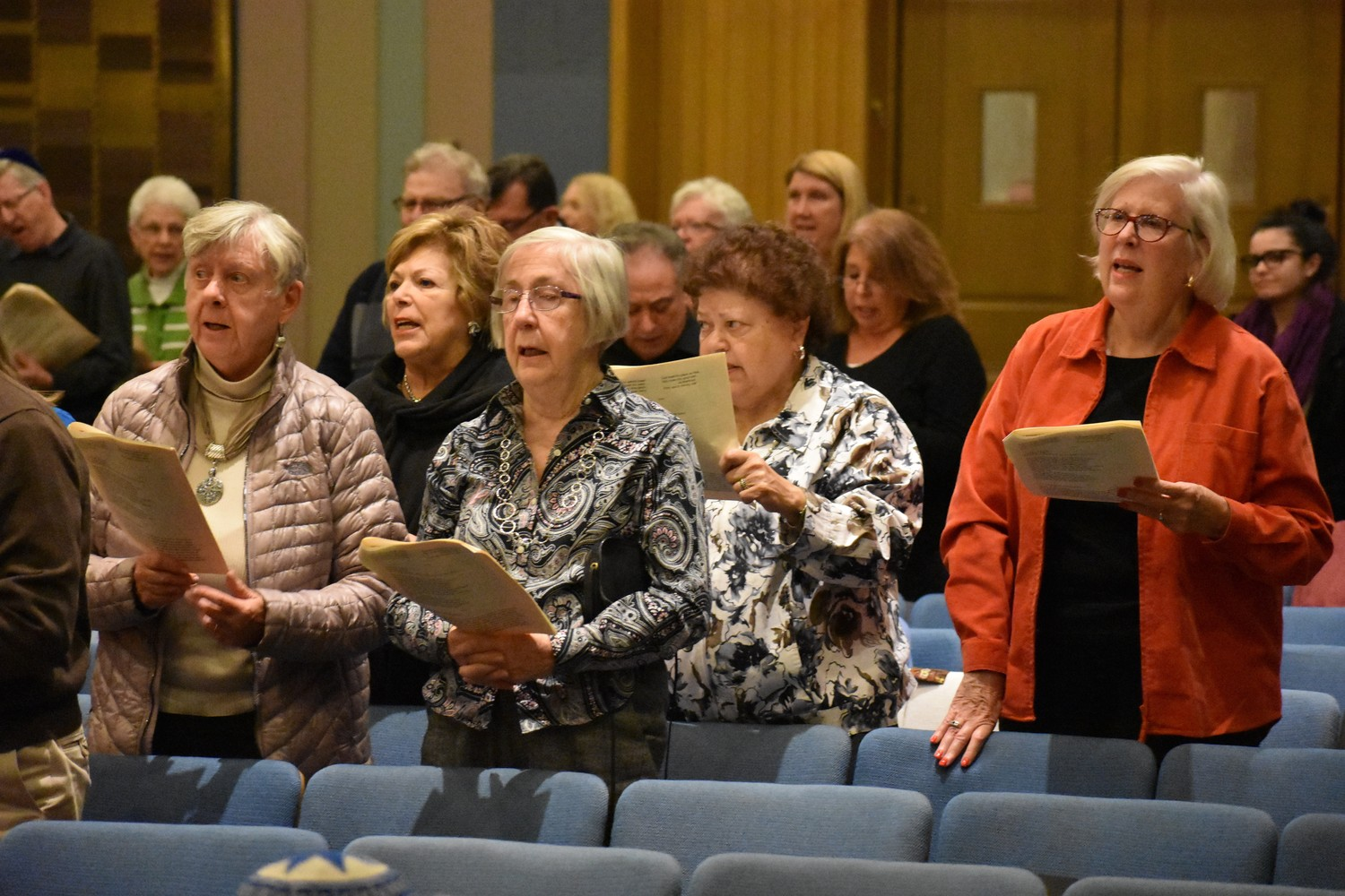 Attendees of the service belted out songs of thanks.