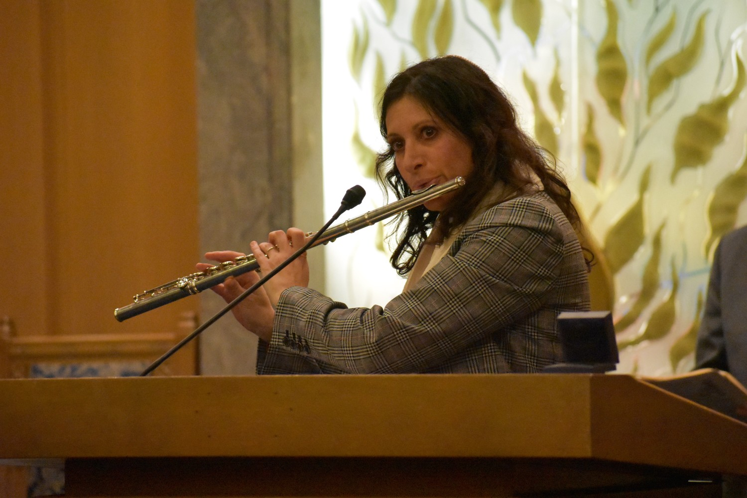 "Cantor Nancy Dubin, of Temple Am Echad in Lynbrook, played the flute during ""America the Beautiful."""