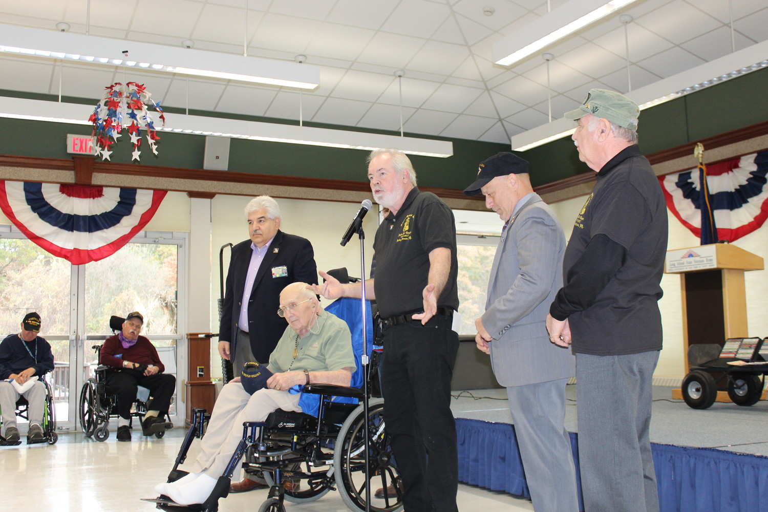 Jerry Lange, center, told veterans at the Veterans Home in Stony Brook about the fraternity and thanked them for their service on Nov. 18.