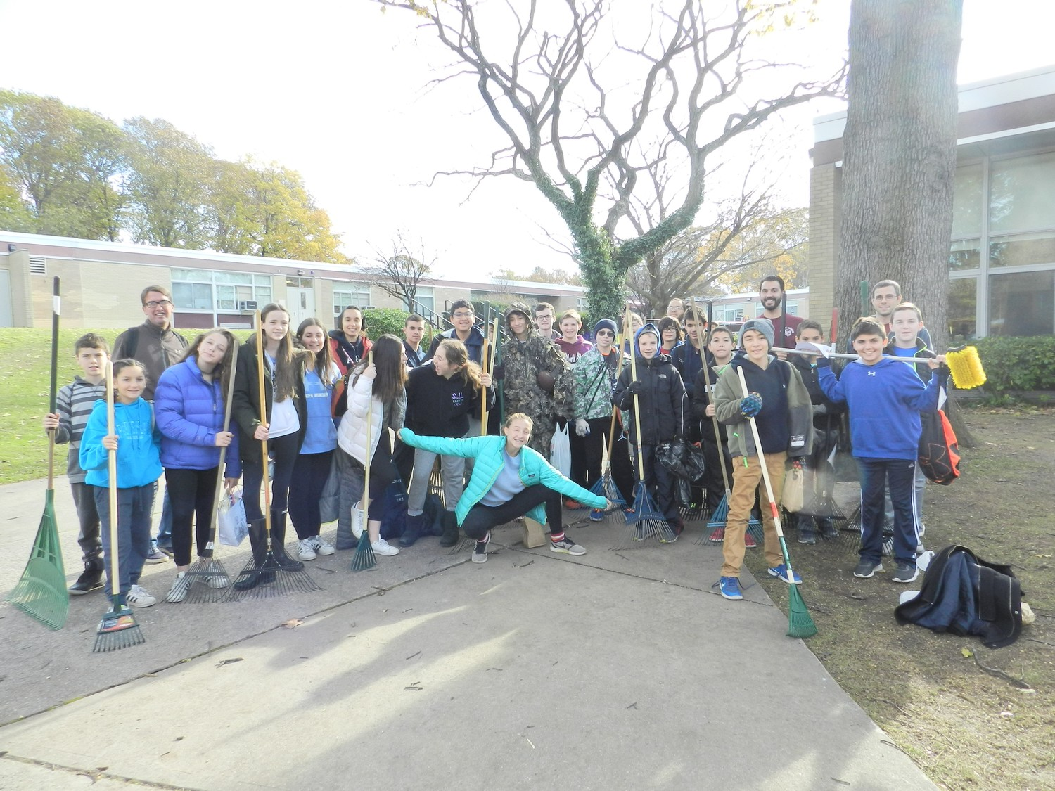 "Students in the ""Raking a Difference"" group traveled to eight houses in the community to rake up leaves."