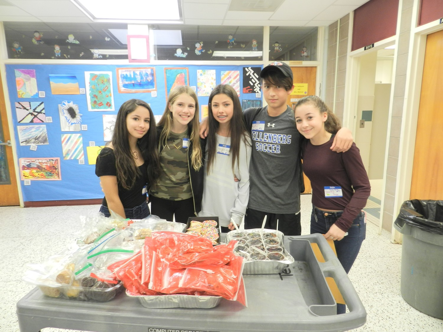 Eight graders Chiara Marzovilla, far left, Lillie DiStefano, Morgan Klein, Jackson Aquino, and Deanna Pepe sold baked goods to raise money for hurricane relief.
