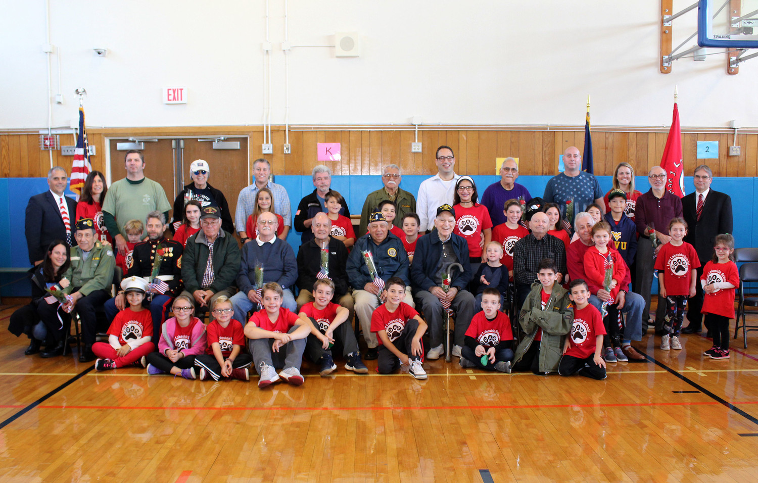 School officials join veterans at Levy Lakeside School for a special Veteran's Day assembly.