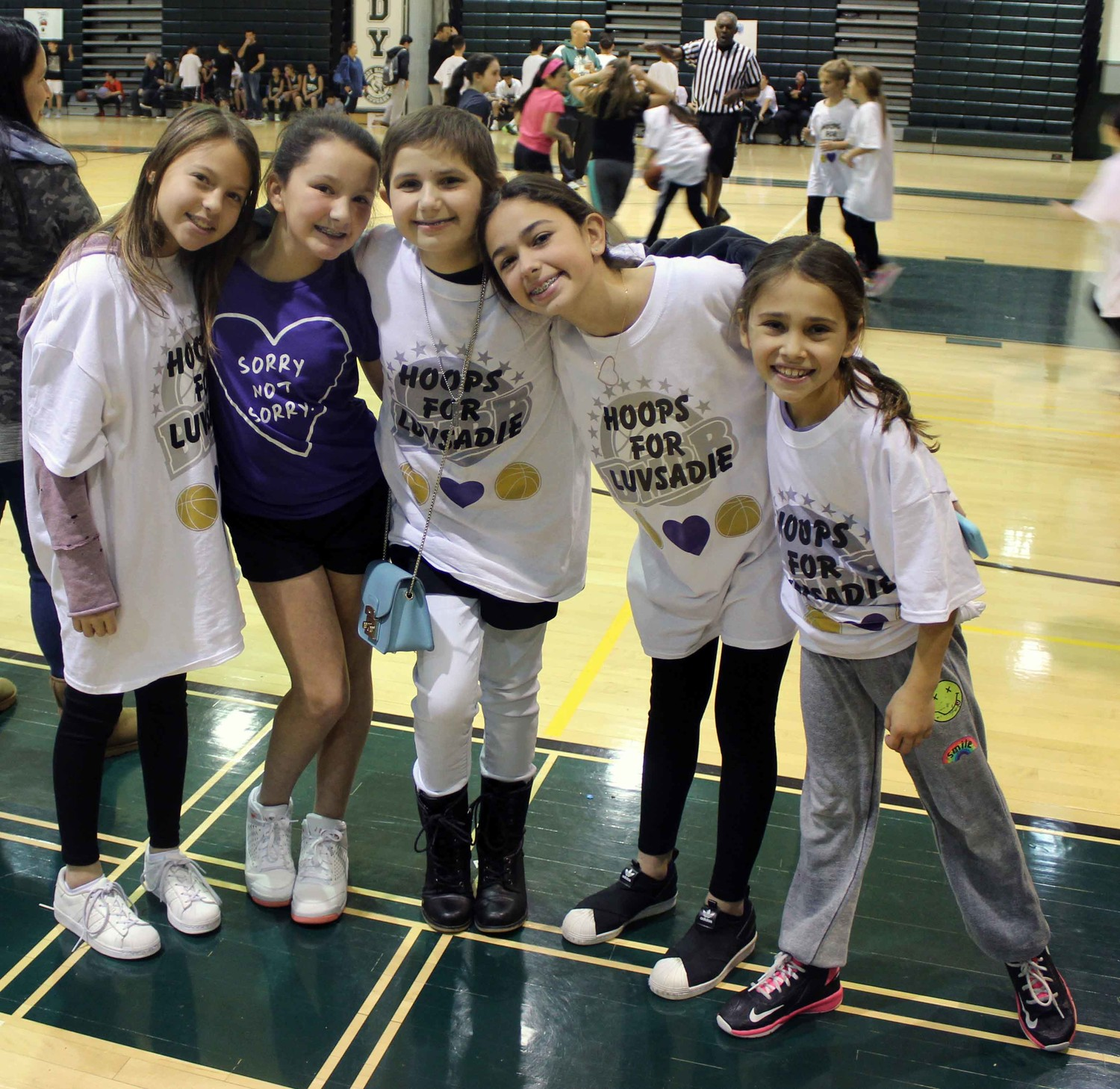 "Sadie Freifeld, center, was diagnosed with neuroblastoma for the second time in March. She is pictured with her friends Maddie Wolin, left, Billie Lombardo, Bella Leicht and Emily Gass at a basketball tournament in her honor called ""Hoops for Sadie,"" which raised over $20,000 for the NYU Winthrop Cancer Center for Kids where she is being treated."