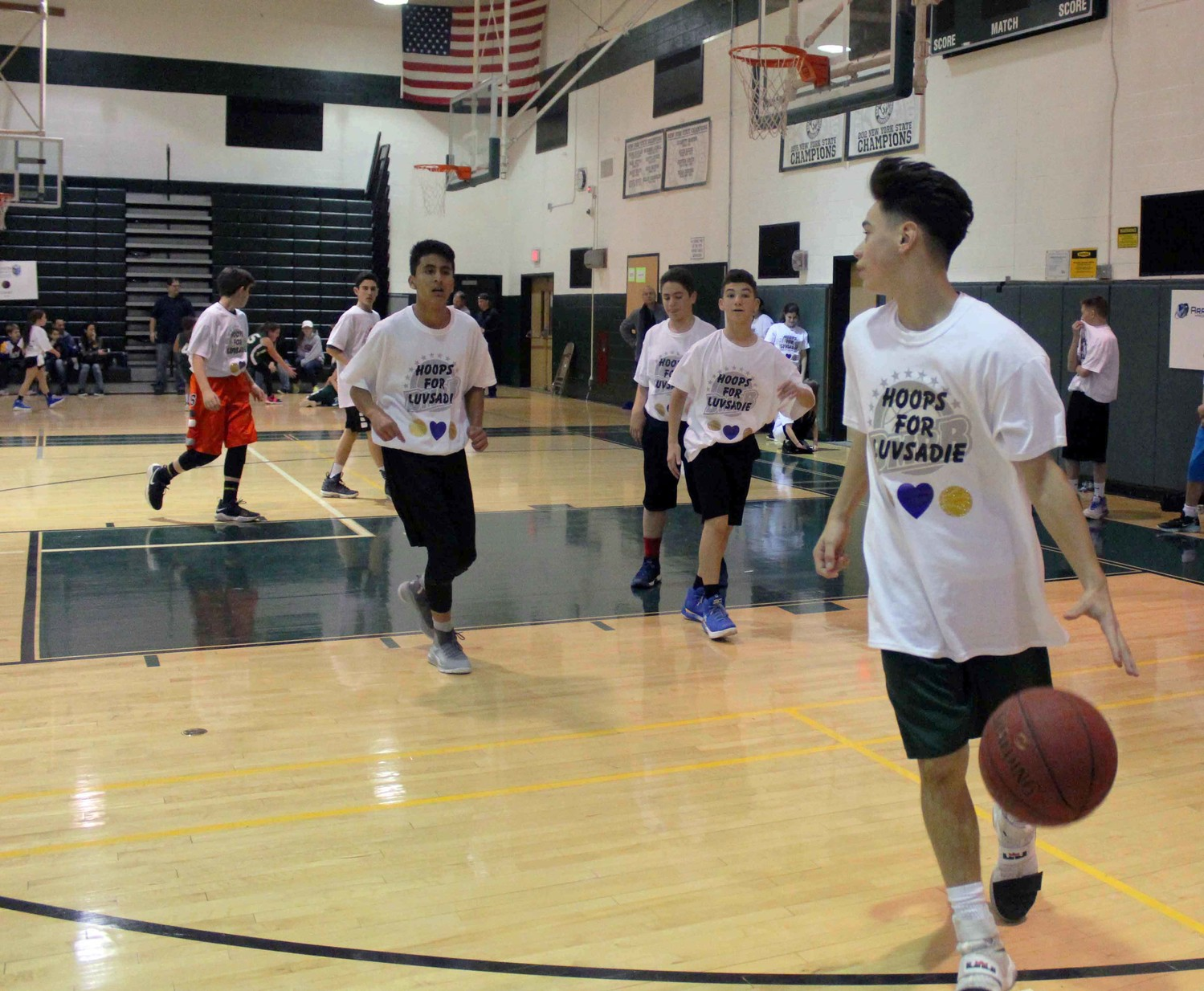 "Alex Celeiro, an eighth-grade student at Grand Avenue Middle School, far right, tried to lead his team to victory in the Bellmore-Merrick Basketball League's ""Hoops for Sadie"" tournament."