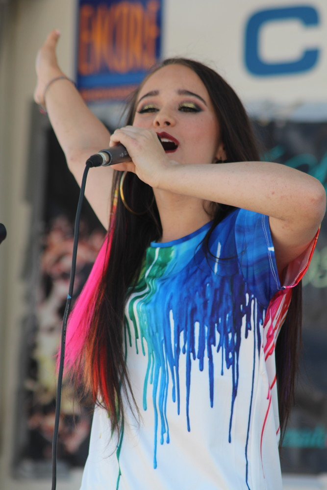 Brianna McDonough, a junior at Calhoun High School, was recently accepted into the National Society of High School Scholars. McDonough, who performs at numerous community and charity events, is pictured here singing at last year's Long Beach Pridefest.