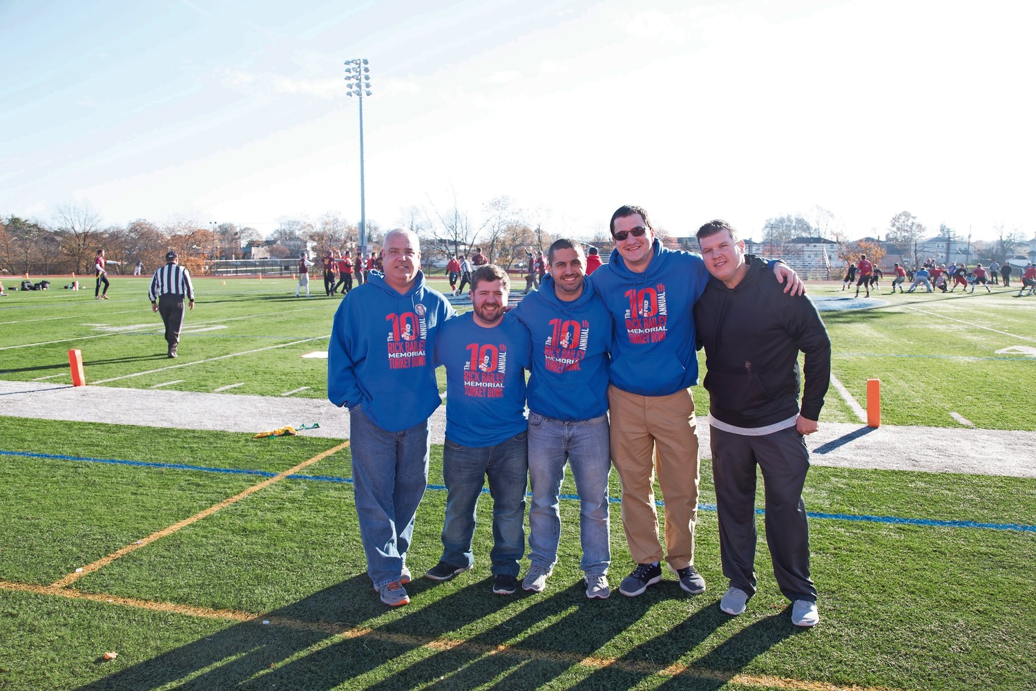 Dozens of MacArthur High School alumni attended the 10th annual Rick Bailey Memorial Flag Football Tournament on Nov. 25 in memory of the former Generals tight end. From left, James Bailey, Bruce Popko, Coordinator Steve Mazziotti, Matt Levy and Craig DuBeau.