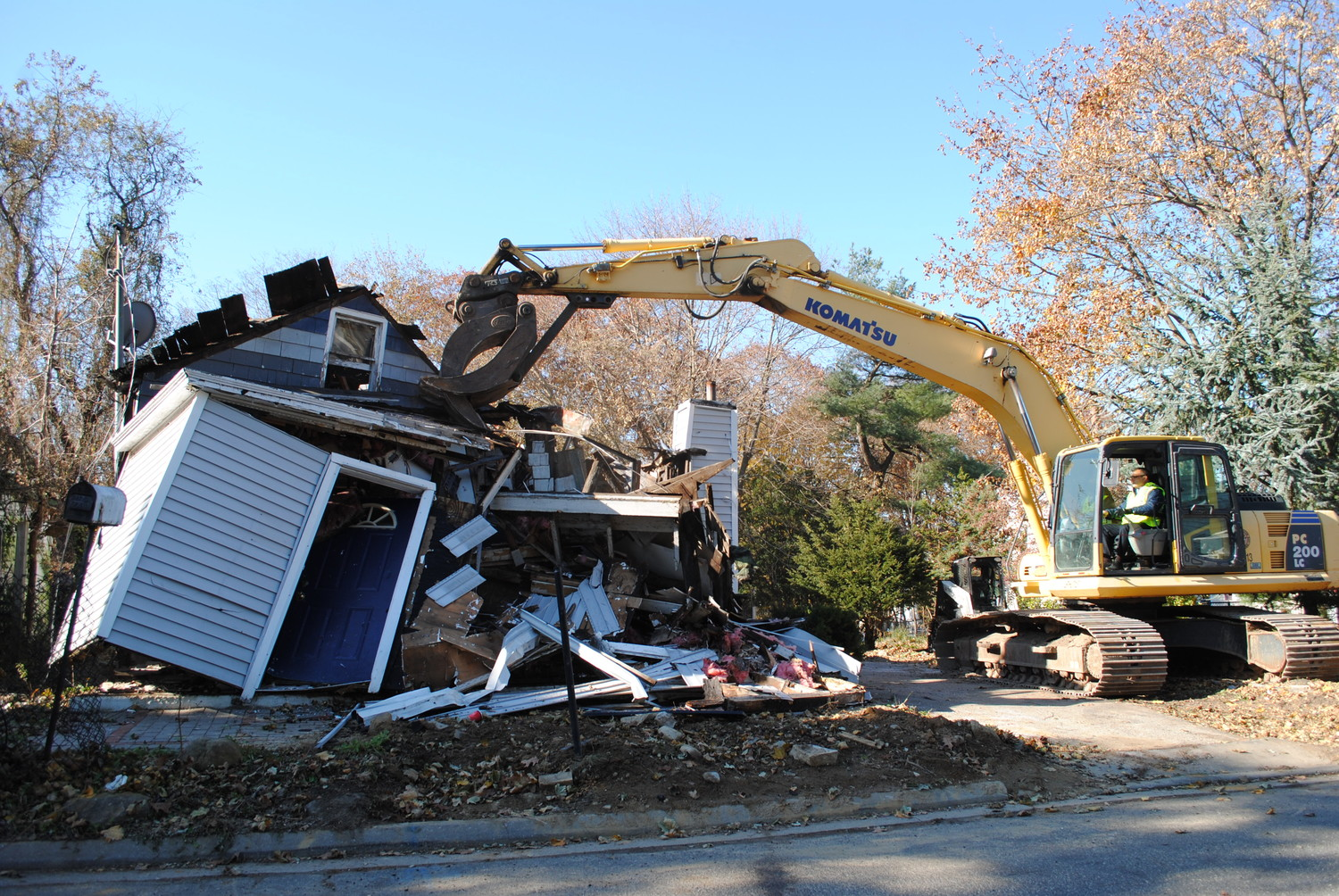 Supervisor Joseph Saladino spent nearly 45 minutes in a backhoe, demolishing a home on Thirteenth Street.