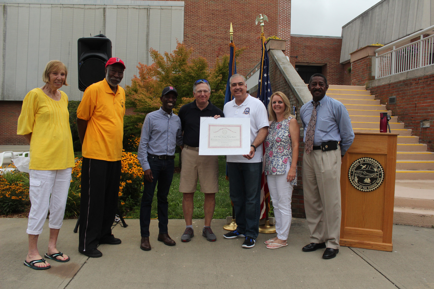 Debra Mulé is often seen at events throughout the community. Last summer she welcomed cadets from the U.S. Naval Academy. From left were Village Historian Cynthia King, school board Members Ernie Kight and Anthony Miller, Capt. Rick Robey, Deputy Mayor George Martinez, Mulé and village Trustee Ron Ellerbee.