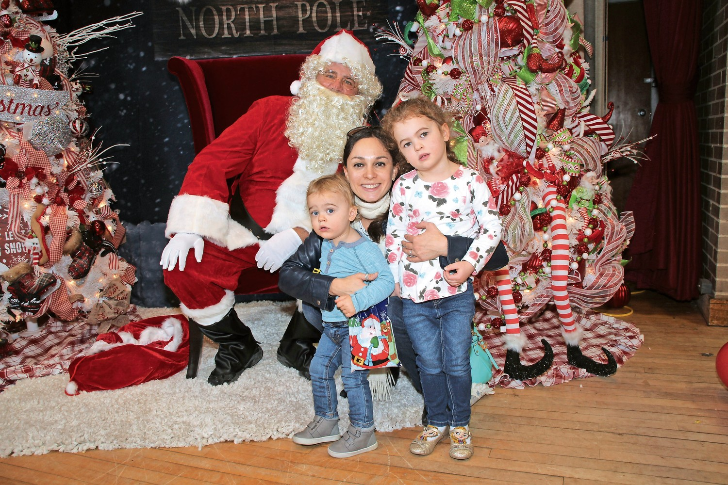 Jennifer Holohan and her children Scarlet, 4, and Christian, 2, met Santa at the fair.