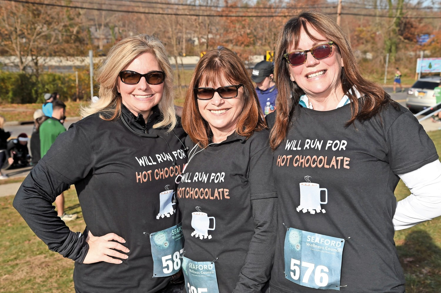 From left, Robin LaBarbera, of Bellmore, Carole Polney, of Lindenhurst, and Casey Phelan, of Wantagh, raced for hot chocolate.