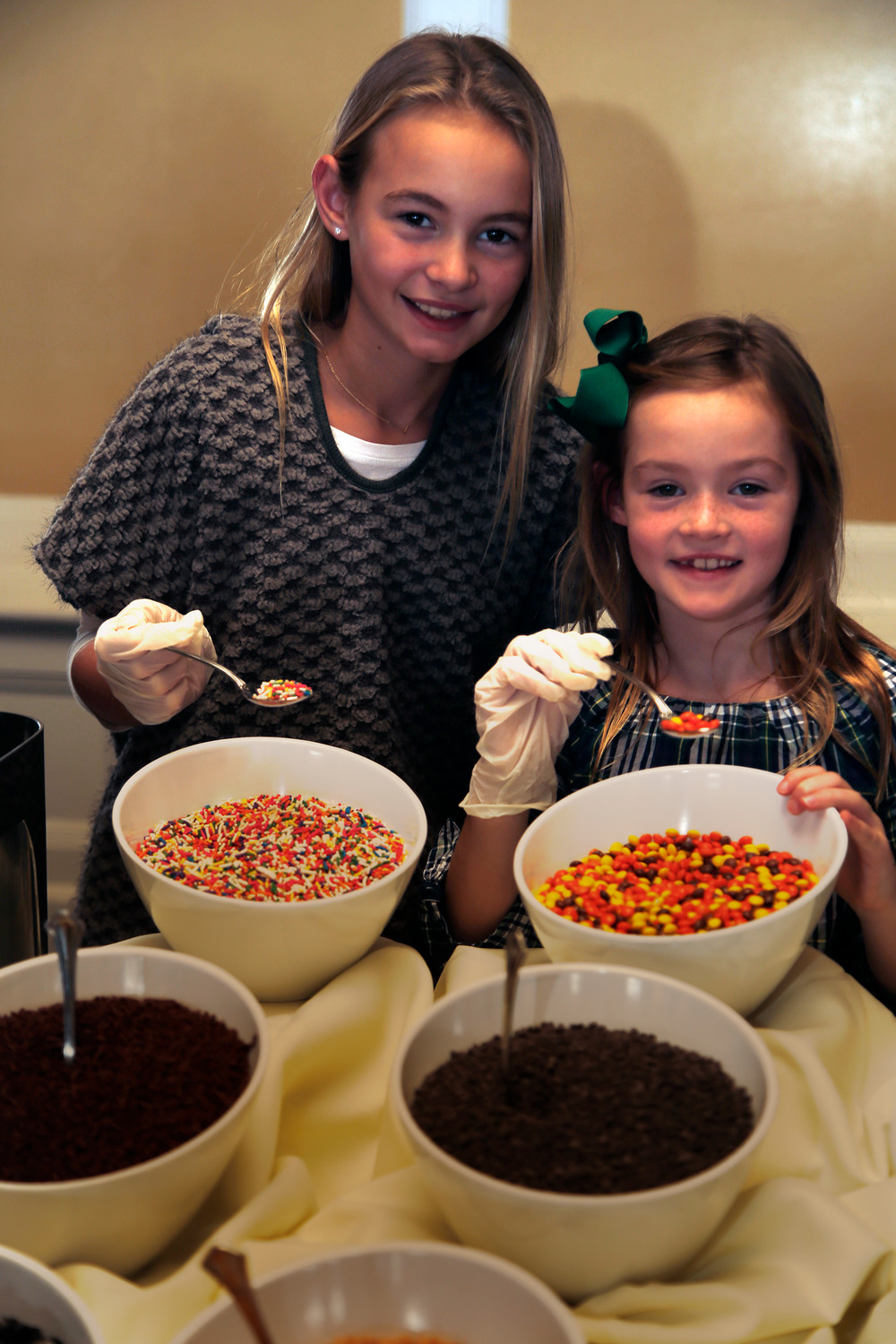 Lily, 11, and Mary Woodstock, 7, manned the dessert table.