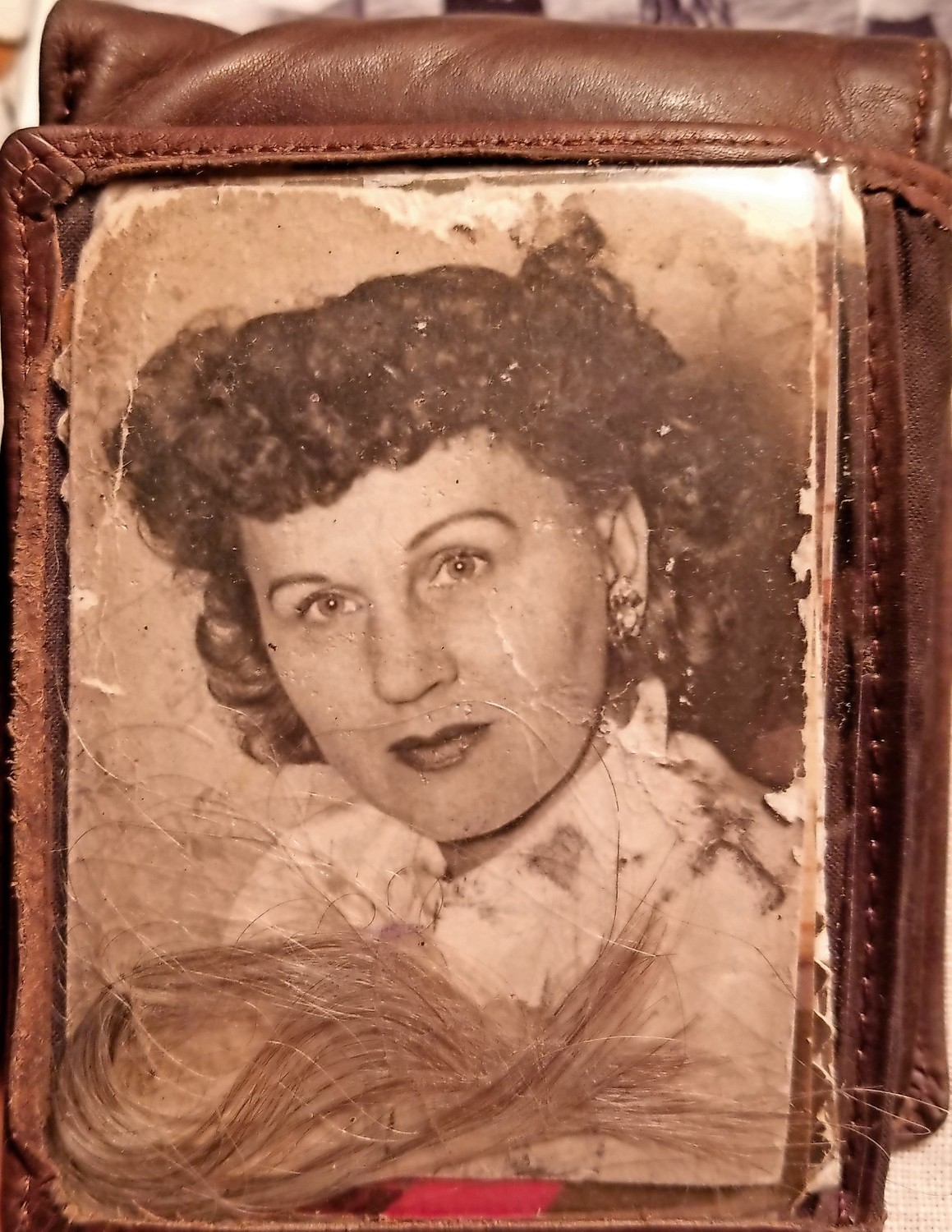 Charlie Franza keeps a photo he took of his late wife, Nettie, in a wallet showcased in his room. He slipped a lock of her hair in the pocket, he said.