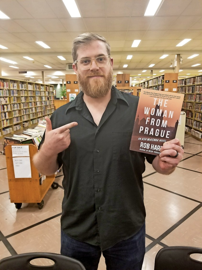 """The Woman from Prague"" author Rob Hart signed copies of the mystery/crime novel for the East Meadow Public Library's Mystery Book Discussion reading group on Nov. 16."