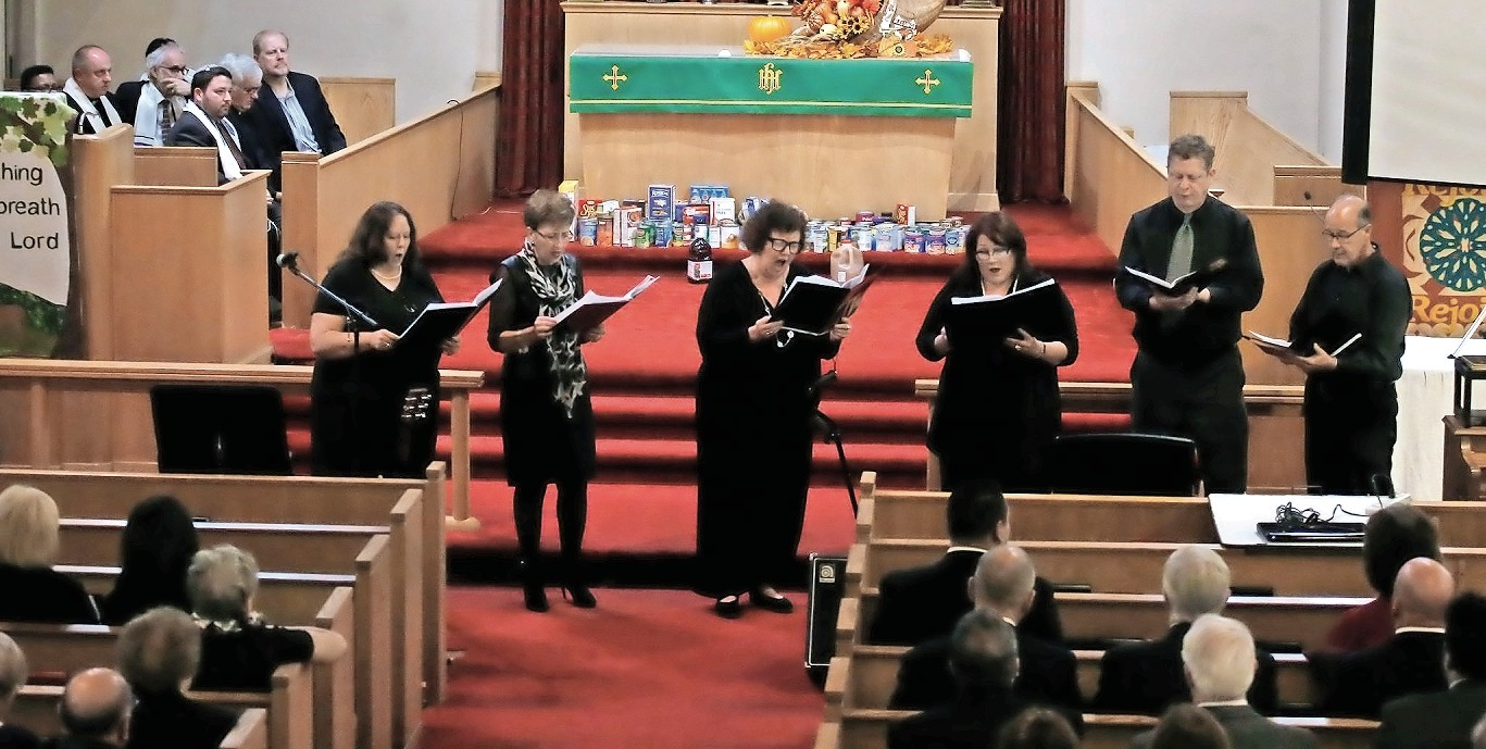 "The East Meadow United Methodist Church choir sang a rendition of ""He Loves Me"" to commence one of East Meadow's long-standing traditions, Interfaith Thanksgiving on Nov. 19."