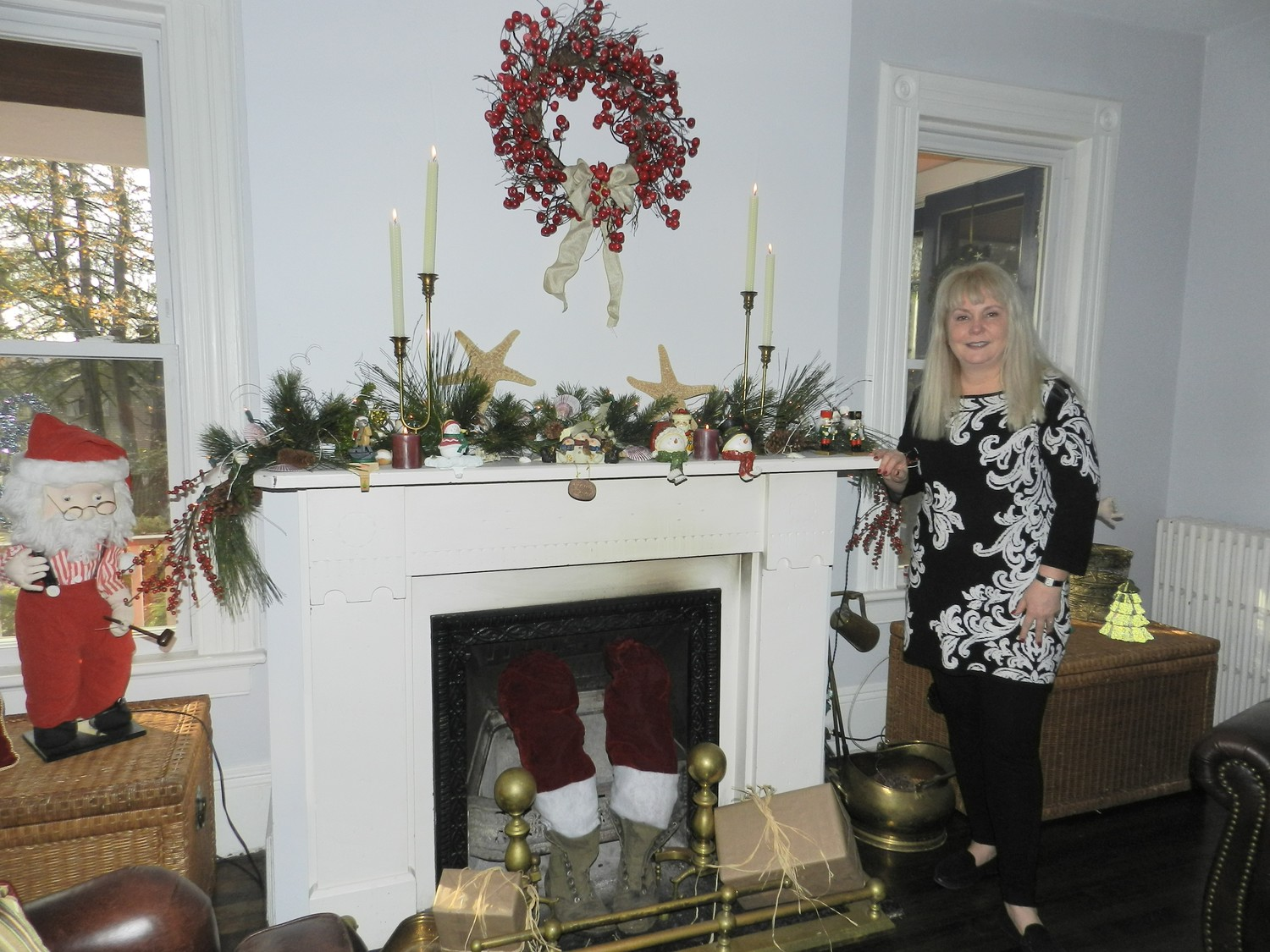 Homeowner Dorothy Davidow dressed up her mantel with cuttings, cranberries and starfish.