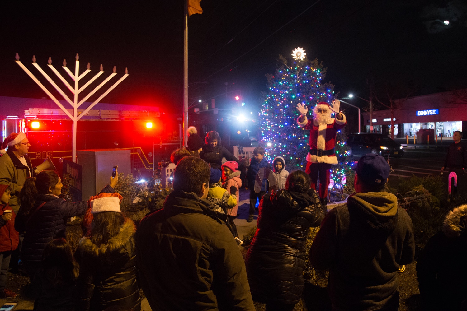 Santa Claus topped off the Hewlett-Woodmere community Christmas tree lighting at the Veterans Memorial Triangle in Hewlett on Dec. 3.
