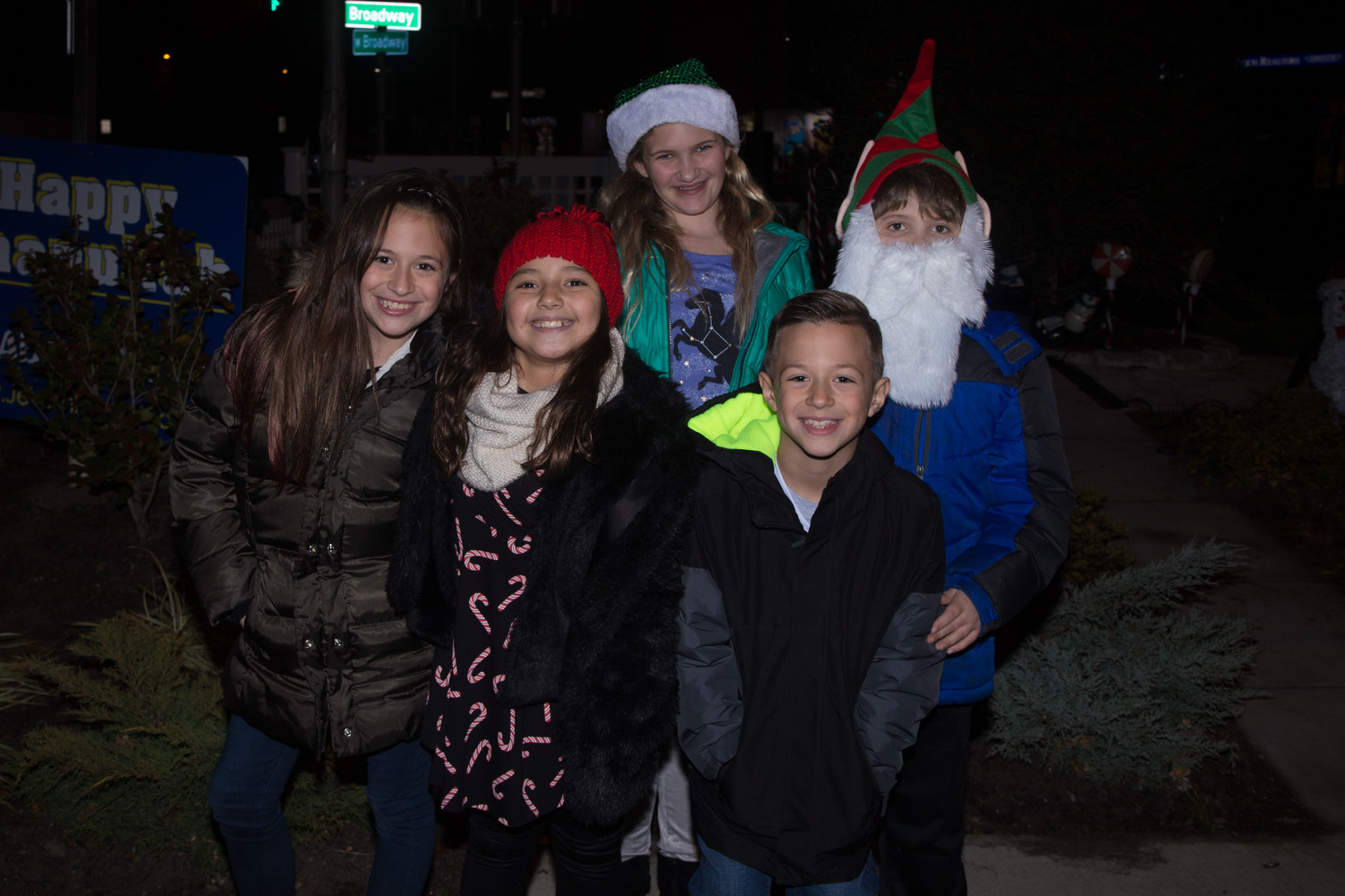 The Christmas spirit and smiles abounded at the community tree lighting last Sunday. From left in front were Lia Piscano and Madison Navarijo, both 9, and James Piscano, 7. In back were Stella Fratti, 11, and Bobby Fratti, 9.