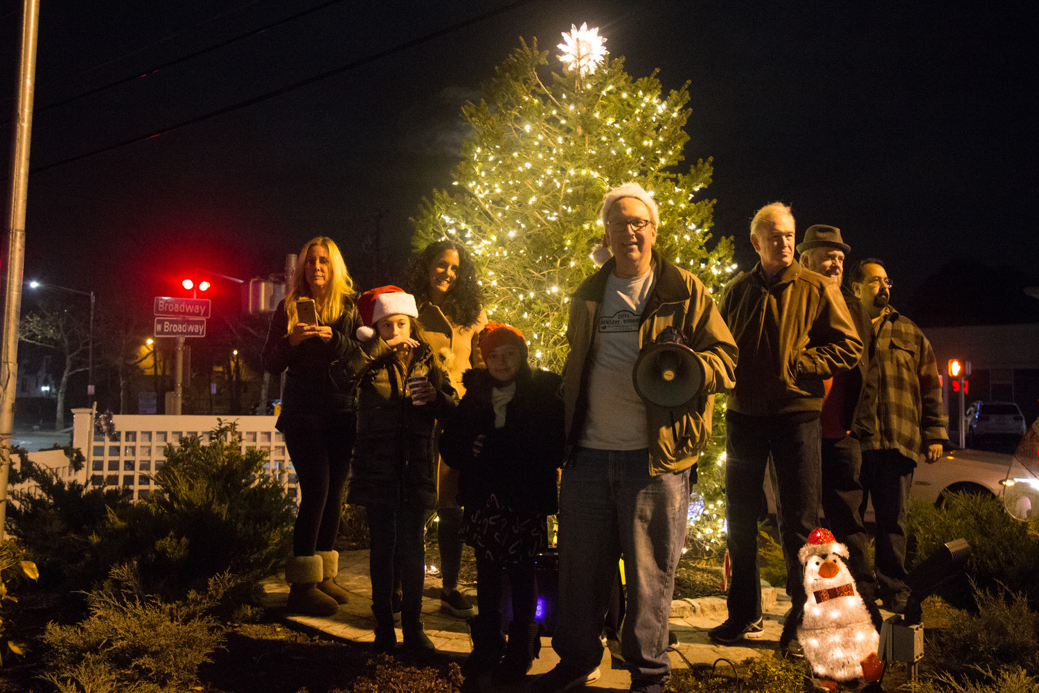 Hewlett-Woodmere Business Association President David Friedman, center, with friends at the tree lighting, including County Legislator Howard Kopel (R-Lawrence) to his right and HWBA 1st Vice President John Roblin.