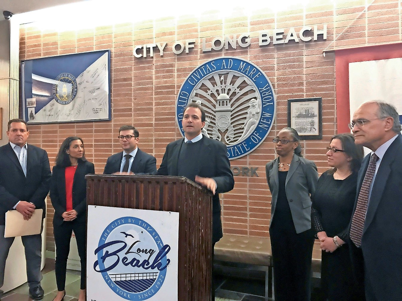 City Council Vice President Anthony Eramo, center, announced at a news conference on Tuesday that the council was supporting a measure to prohibit the sale of tobacco products to those under 21.