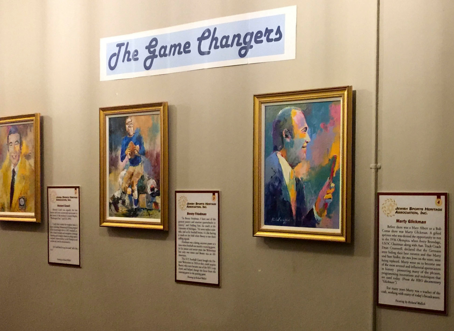 """The Game Changers"" an exhibit of 13 paintings by Richard Wallich is on display at Temple Israel through this month. Above, Benny Friedman and Marty Glickman."
