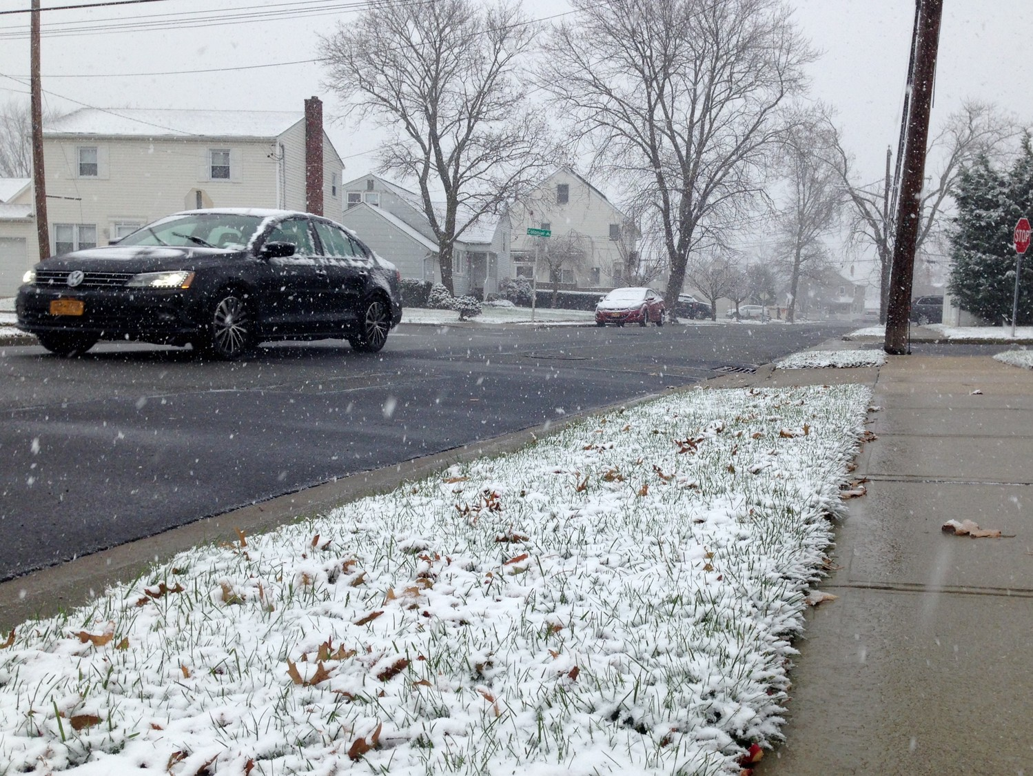 Snow started falling across Nassau County at mid-morning on Saturday. Above, a street in south Merrick.