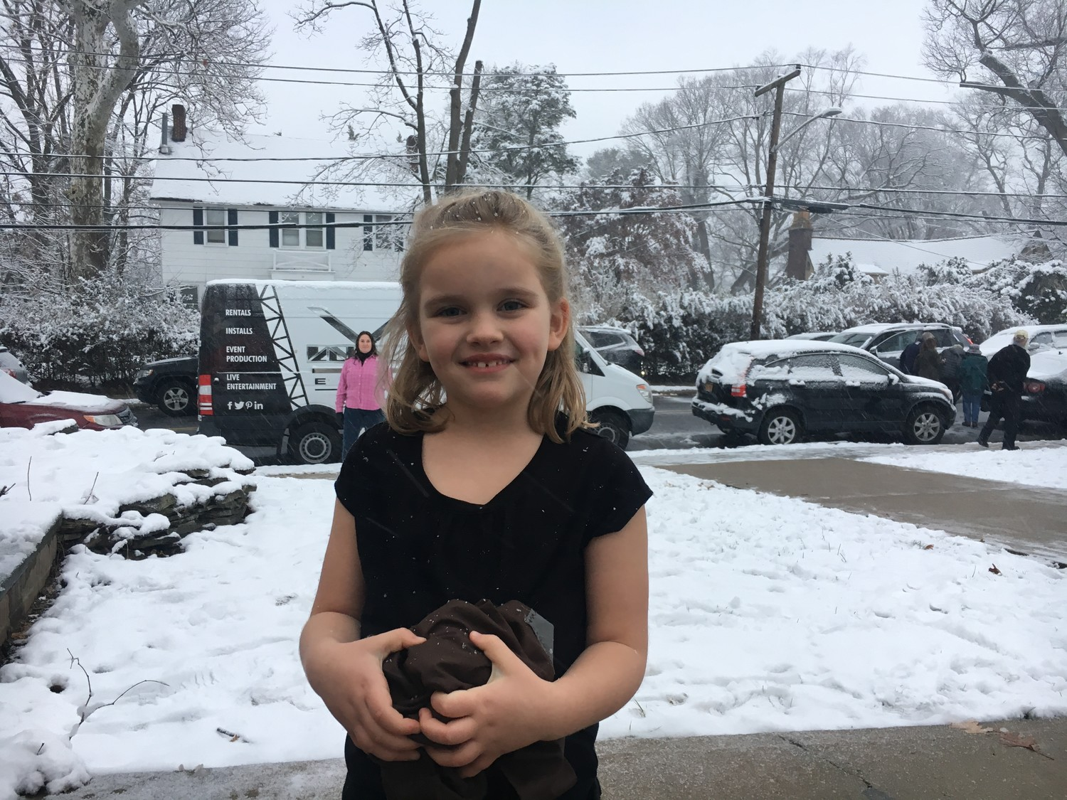Maggie Friedberg, of Sea Cliff, enjoyed the first flurries of the season without a coat, since temperatures didn't drop as had been predicted.