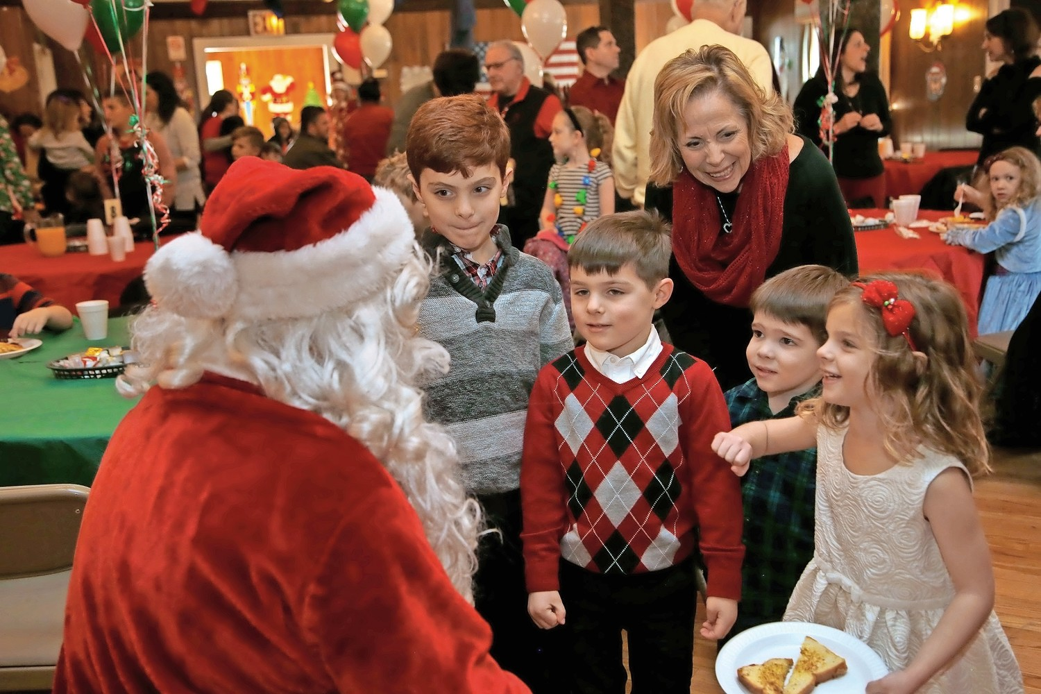Ryan DelGiorno, 8, left, his brother Patrick, 5, Thomas Risolo, 4, and Lily DelGiorno, 5, got to have breakfast with Santa Claus on Dec. 2.