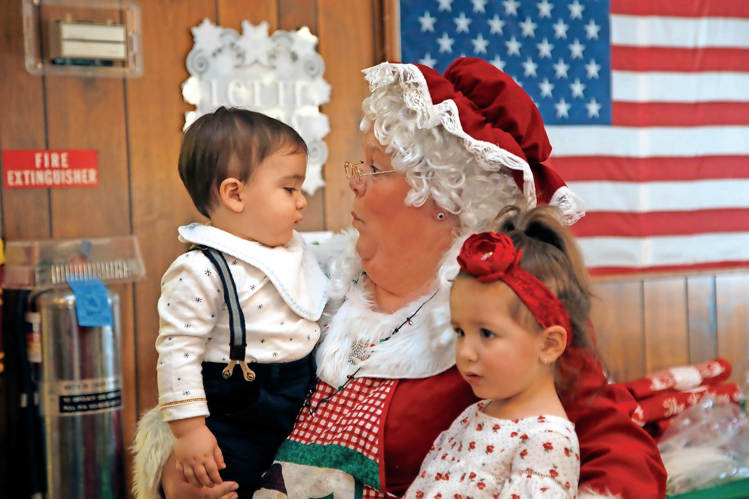 One-year old Antonio Cervoni and his sister, Alessia, 2, met Mrs. Claus.