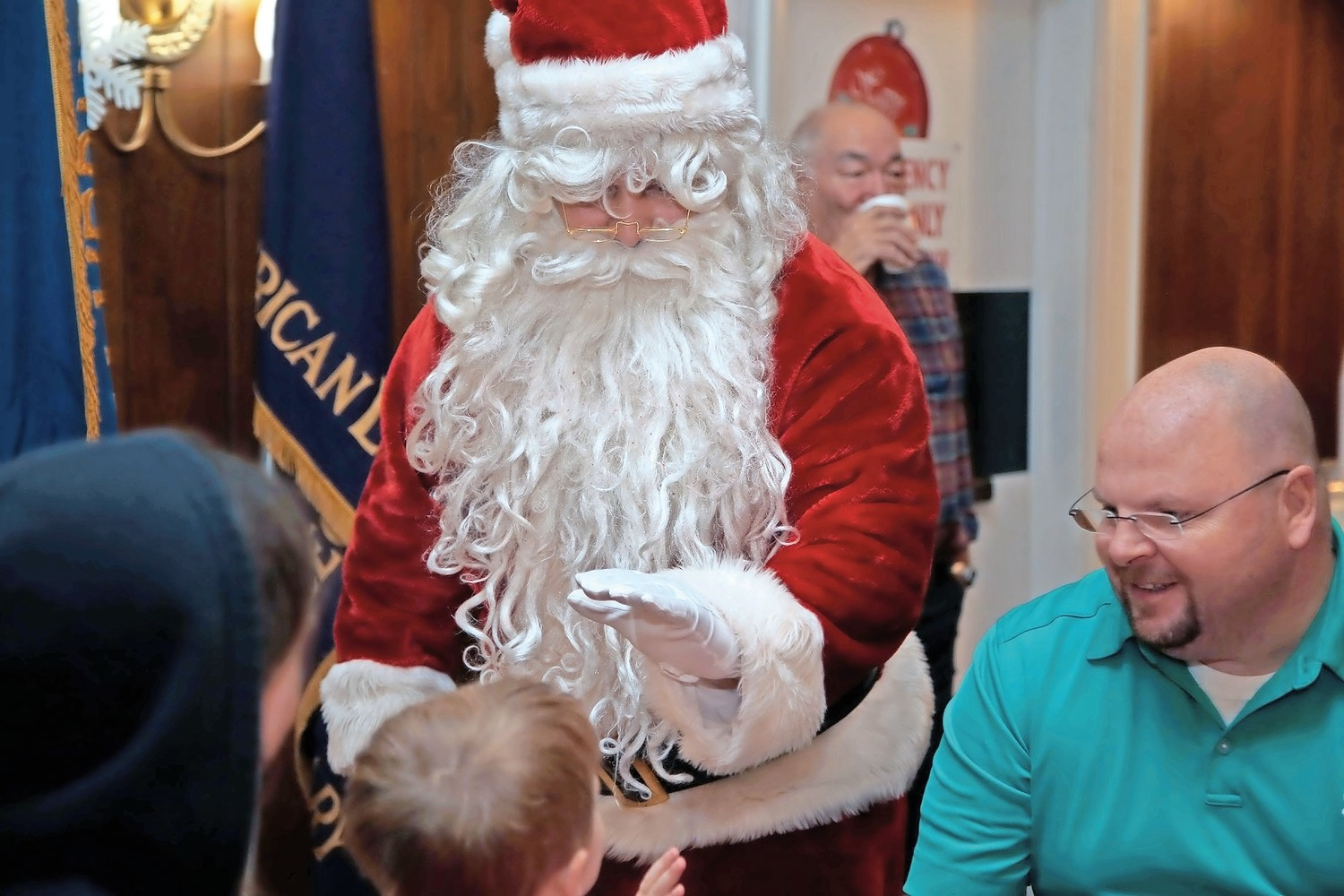 Santa greeted children with high-fives.