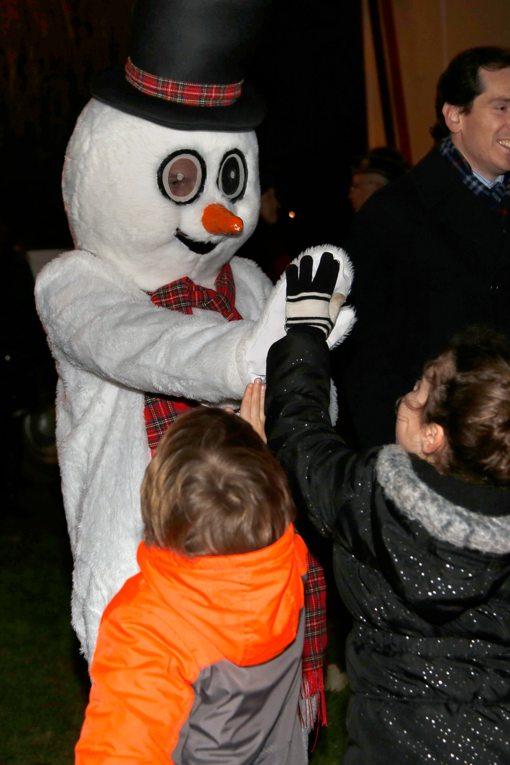 Frosty the Snowman greeted children at the lighting.