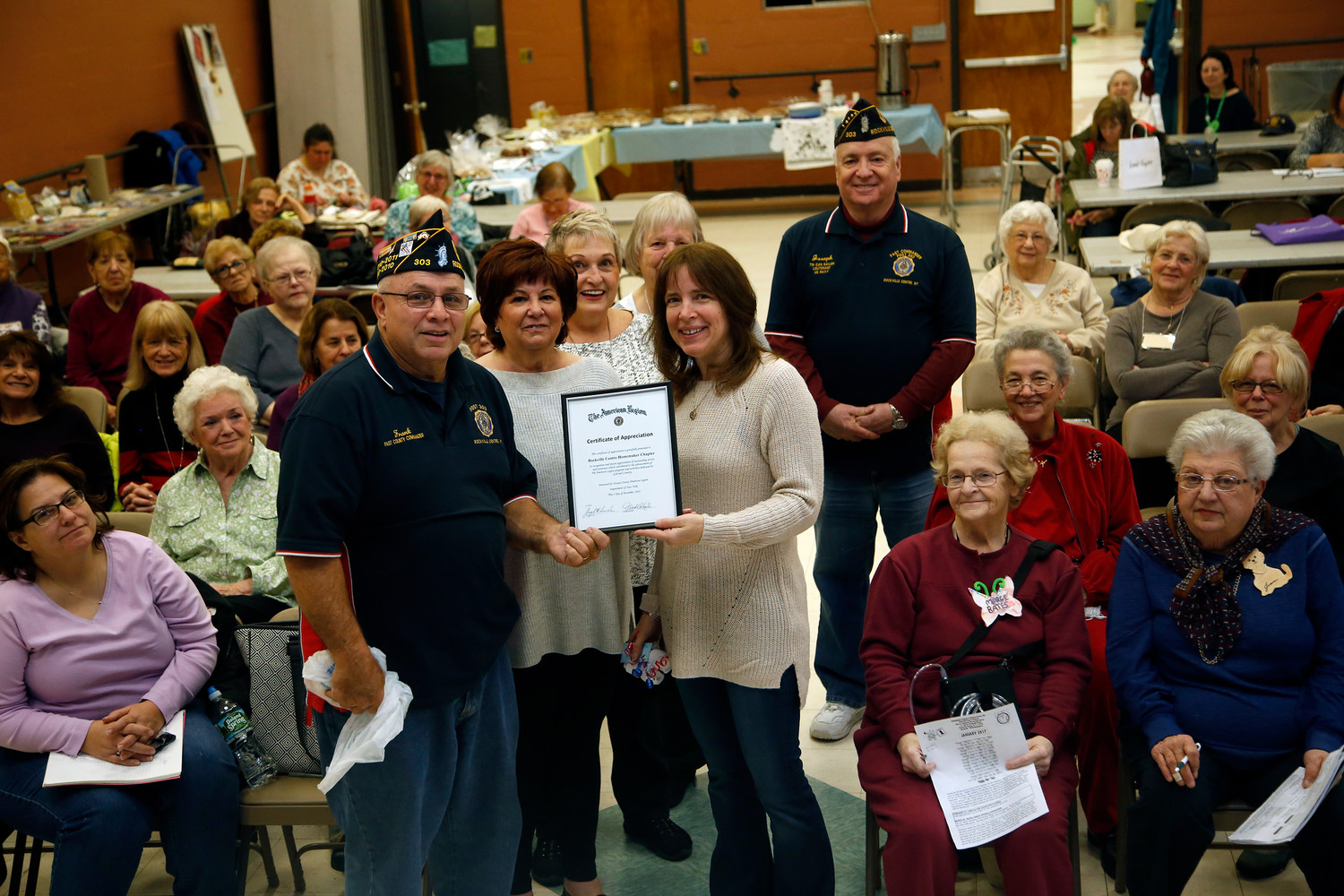 The Rockville Centre Homemakers continued its tradition of donating socks to local veterans. Above, American Legion Post 303 Commander Frank Colon Jr. and past commander Joseph Scarola, pictured last winter, presented the group's council co-presidents Karen Alterson, left, and Marianne Grandazzo with a certificate of appreciation.
