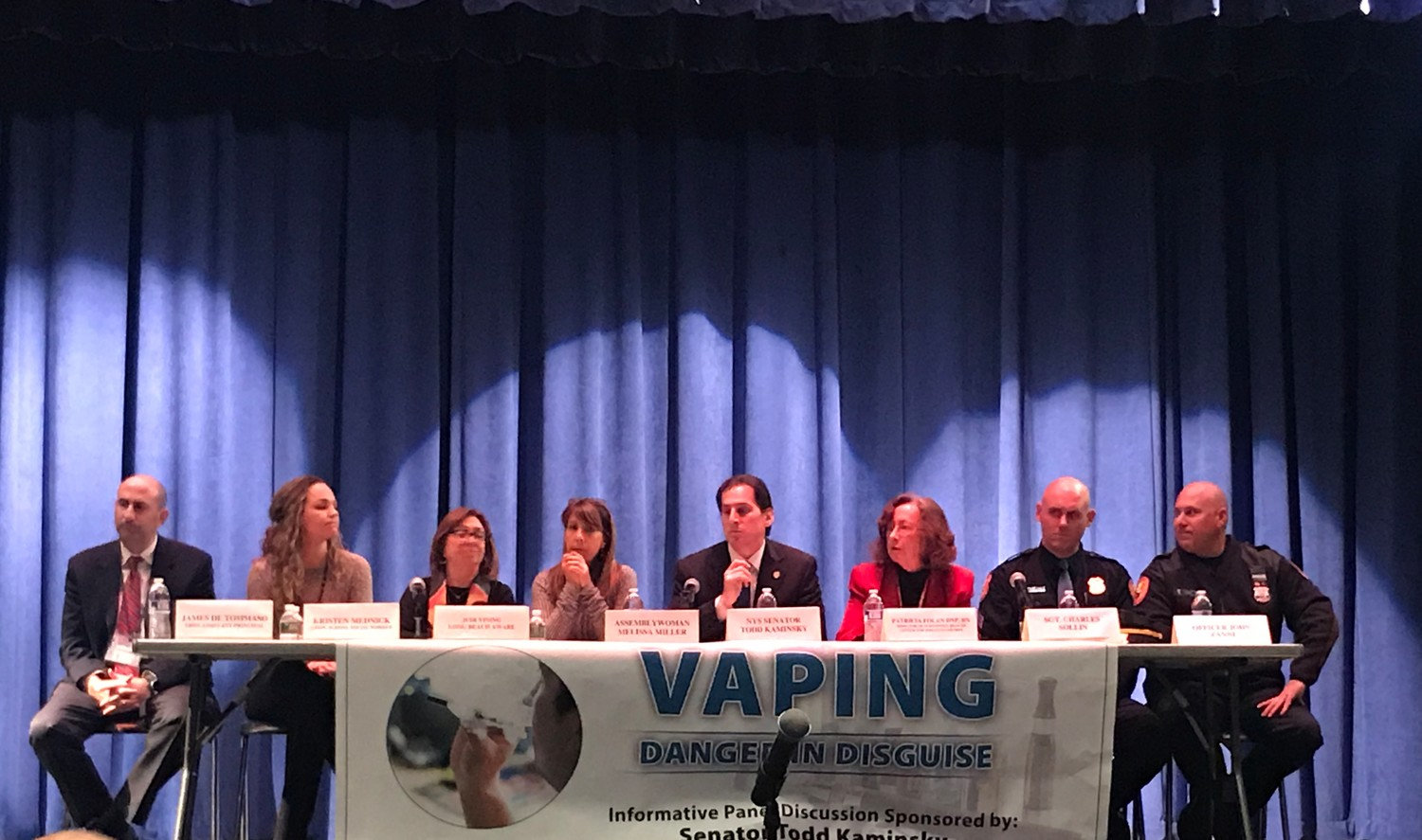 Vaping was the subject of a forum at East Rockaway Junior-Senior High School last week. Among the speakers were, from left, James DeTommaso, the high school's assistant principal; Kristen Mednick, a school social worker; Judi Vining, executive director of Long Beach Aware; State Assemblywoman Melissa Miller; State Sen. Todd Kaminsky; Patricia Folan, director of the Northwell Health Center for Tobacco Control; Nassau County Police Sgt. Charles Solan; and NCPD Officer John Zanni.