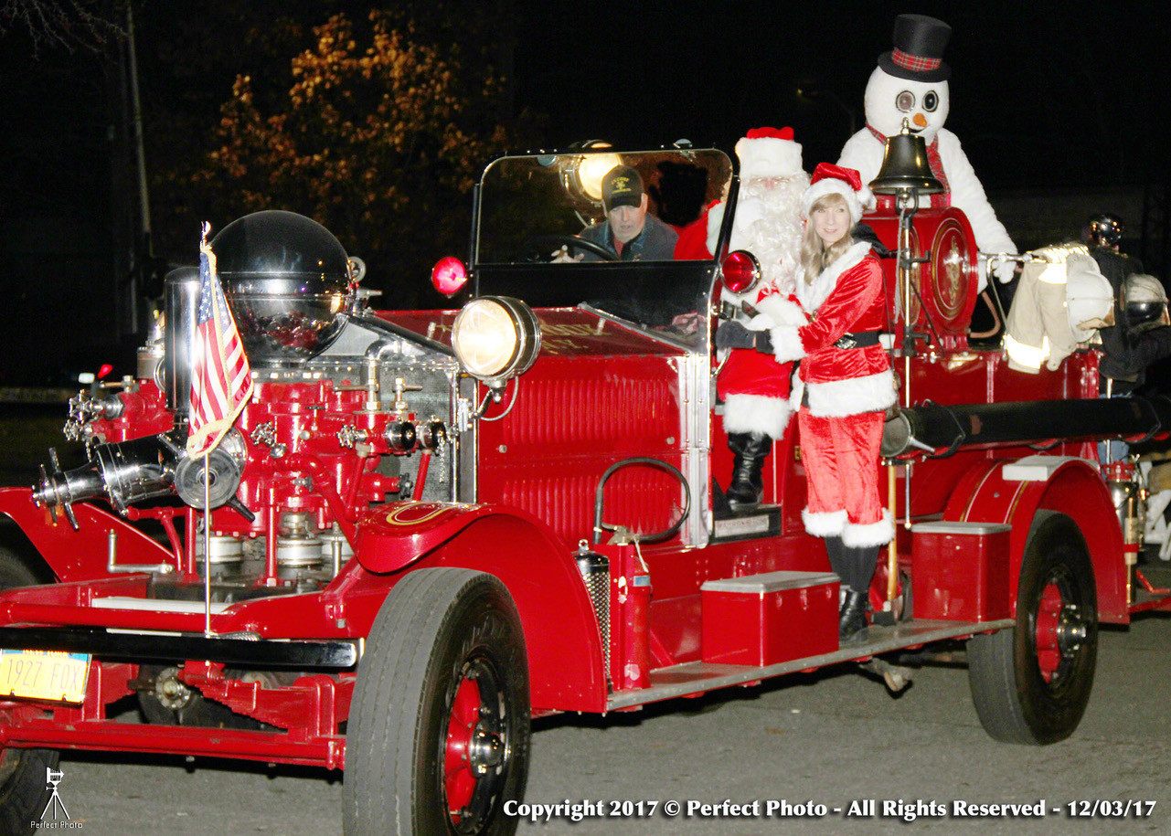 Santa, Mrs. Clause and Frosty the Snowman took a ride with Lynbrook Fire Chief Carl Lengel in a vintage fire truck.
