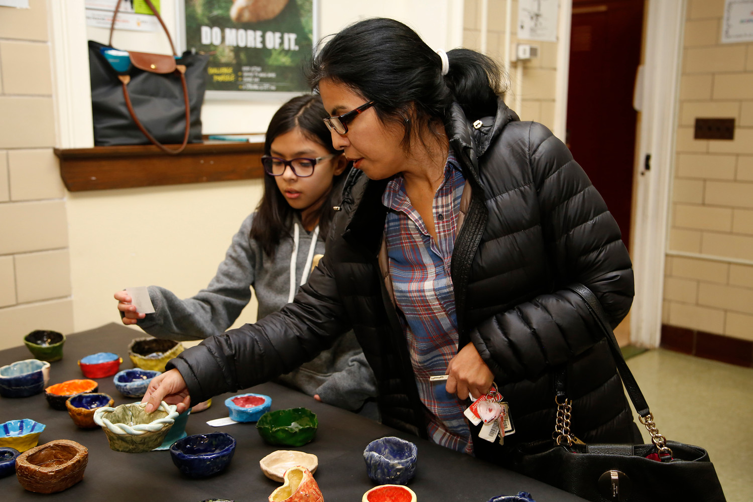Emily Valdebenito, 9, and her mom, Ledda, picked out a handmade bowl at the Empty Bowls fundraiser on Nov. 30.
