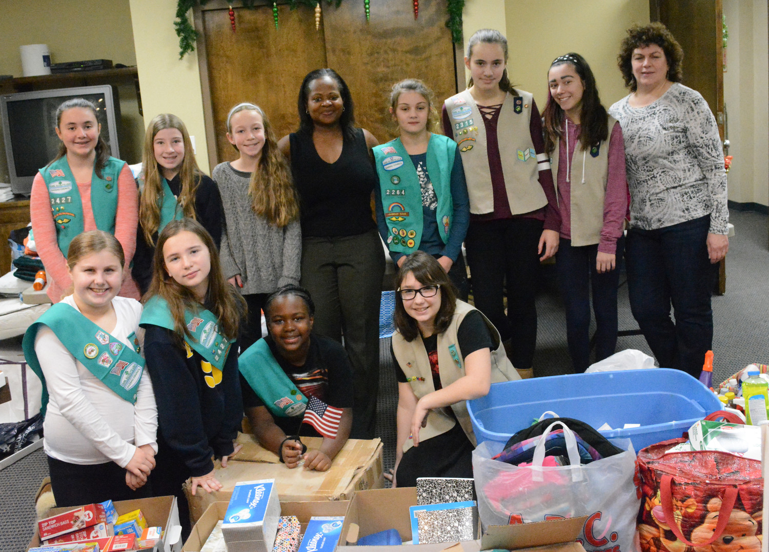 Girl Scouts from Troop 2427 spent a snowy Saturday morning sorting through donations to send to hurricane-ravaged areas of Texas, Florida and Puerto Rico.